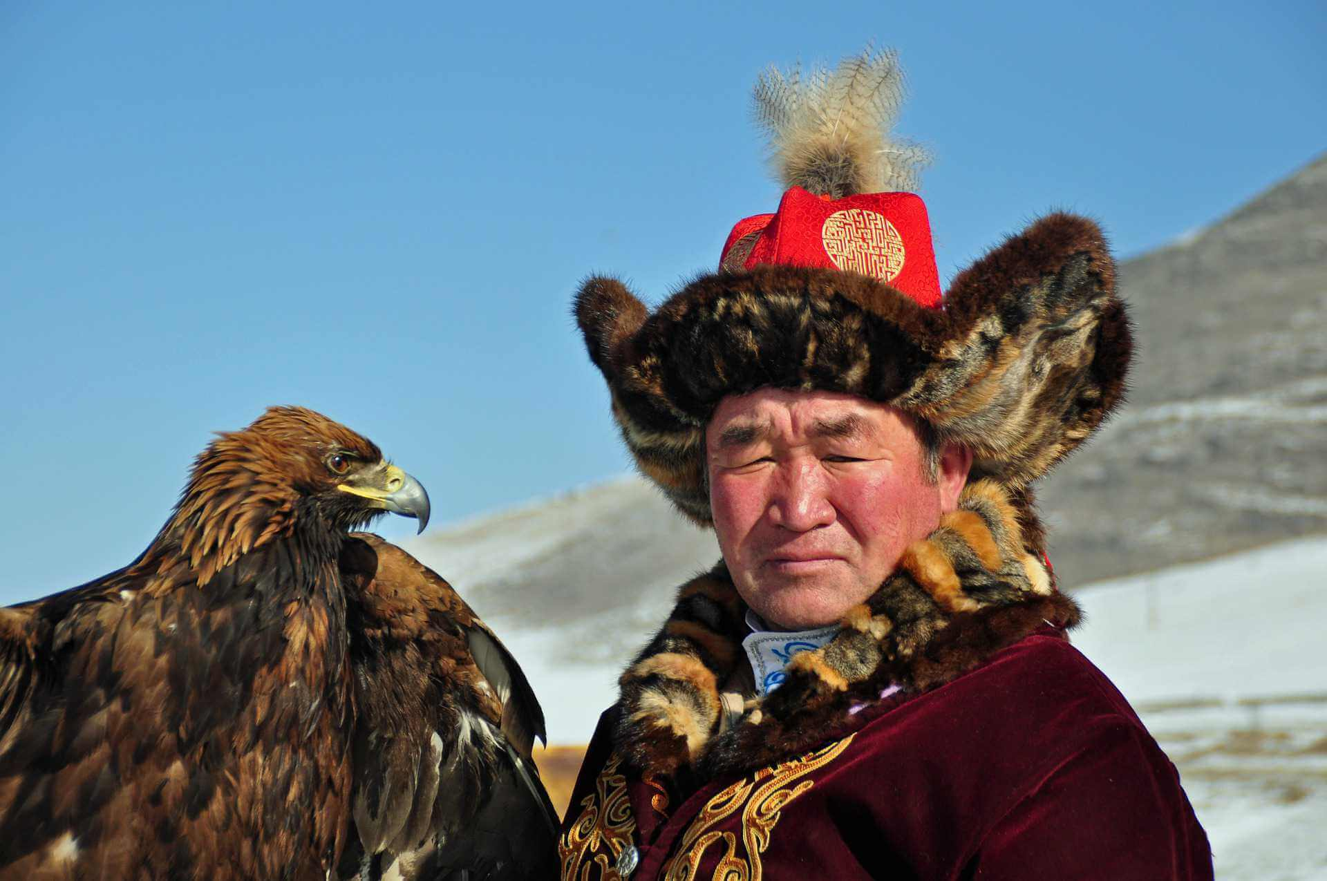 Asian falconer with eagle